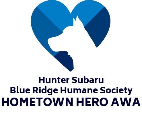 outline of dogs head in blue heart